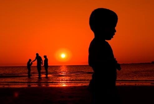 getty_rf_photo_of_boy_on_beach